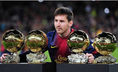 Messi đoạt Quả bóng vàng trong bốn năm liền. Ảnh: AFP.